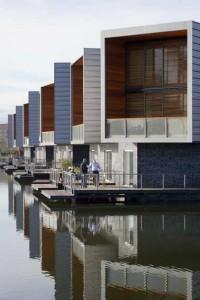 Overzicht 12 waterwoningen aan de entree van Waterwijk