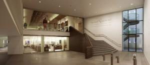 Tentoonstellingsvleugel met beneden gang langs binnenplaats, museumwinkel en boven expositieruimte