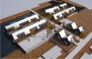 4 Maquette, met rechtsonder vier twee-onder-een-kapwoningen waarvan de bouw volgend jaar gaat starten