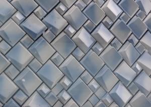 Er zijn drie soorten tegels toegepast als gevelbekleding van de Wolk