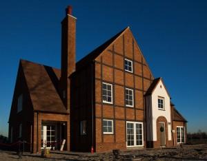 informatiecentrum Tudorpark Hoofddorp Heren 5 architecten, met chimneypots ontworpen door Studio Wieki Somers
