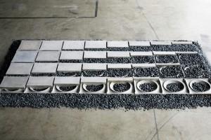 10. Living Pavement, ontwerp Bennie Meek: een straat- en stoeptegel die ruimte biedt aan planten en struiken.