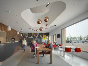 Theatercafé met doorzicht naar de studio, links de geschubde huid van de grote zaal, in de vide koperen lampen van Tom Dixon