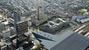 First is de naam van de nieuwe toren tegenover Rotterdam CS, ontworpen door de Architekten Cie. Ook groene dak van het Groothandelsgebouw is duidelijk zichtbaar.