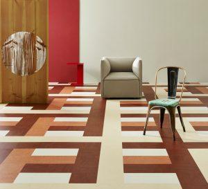 De modulaire Marmoleum vloer voor Forbo heet Weave, omdat het geweven kleurbanen suggereert met diepte.