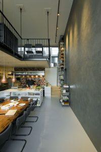 Loft op de begane grond van blok 4, met kookstudio annex buurtrestaurant