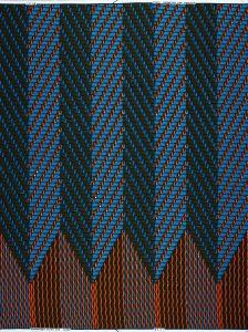 Waxblock VLW1191: In de afgelopen jaren ontwierp  Simone Post verscheidene dessins voor Vlisco. Voor dit patroon liet ze twee verschillende zigzagpatronen in elkaar overlopen, geïnspireerd op het echte tweed