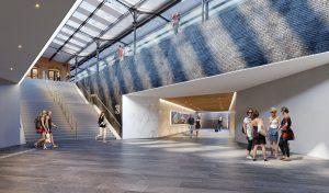 Nieuwe reizigerstunnel met trapopgang en glasstroken in monumentale overkapping
