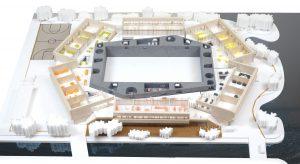 Studio Selva ontwerpt één compact gebouw met de sporthal als hart, omgeven door een 'rots' met daaromheen de speelleerpleinen. De domeinen zijn ondergebracht in vleugels aan de buitenzijde
