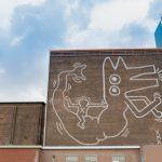 Restauratie muurschildering Keith Haring