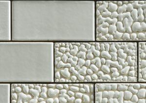 Stenen met druppelglazuur in Parkrand Amsterdam van MVRDV